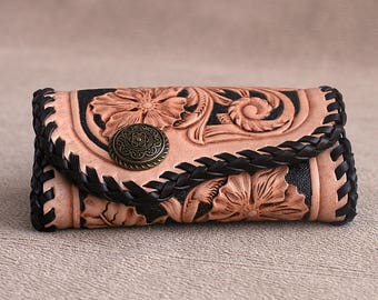 Handmade handtooled leather keyholder with hand-carved floral pattern in Sheridan style