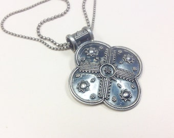 Vintage, signed, sterling silver pendant and chain in the style of an ancient civilisation, perhaps Mayan or Aztec.