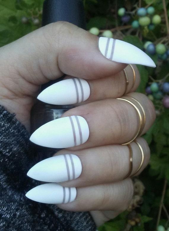 Matte White Stiletto Nails Negative Space Striped Acrylic