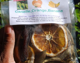 Preparation for rum arranged leaves of cinnamon, Orange banana on the island of Reunion