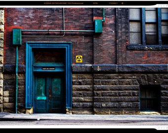 Fallout Shelter Sign Above Blue Green Door on Old Brick Building Fine Art Print