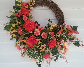 Spring ivy wreath with yellow and orange silk flowers