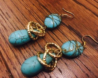 Turquoise worked in golden thread