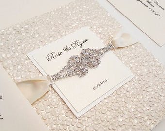 Luxury invitations etsy luxury pebbles pocketfold wedding invitation in ivory with rhinestone connector l bilingual stopboris Choice Image
