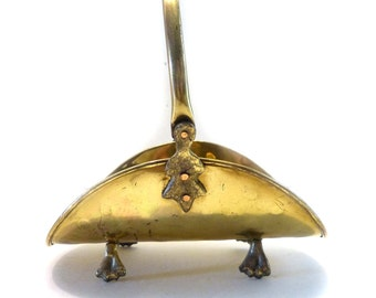 Small Decorative Brass Fireside Basket Articulated Handle And Claw Feet