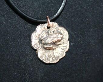 Bronze Frog on lilypad