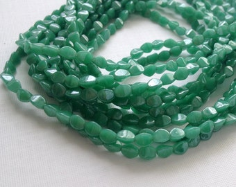 Green glass pinch beads, Czech glass beads, luster opaque green strand of 50