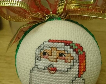 Cross stitch Christmas bauble ready to be hung on your Christmas tree