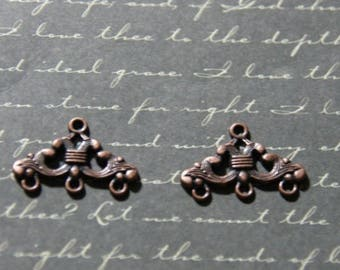 2 connectors with volutes 16x24mm coppered metal