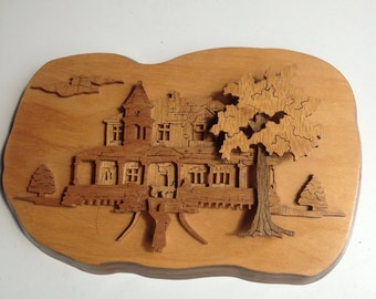 Raised carved wood house scene