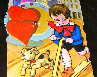 Antique valentine post card, pre-1910, boy with scooter and dog, embossed and with spinning dial, excellent condition, made in Germany