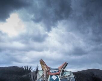 Mongolian horse saddle photography print. Rustic horseback riding Asian decor. Eastern travel wall art. Black horse and blue sky photograph
