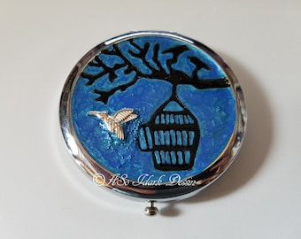 Bag or Pocket mirror made with Pocket - the birds that escapes from its cage