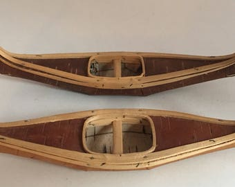 Mid century replica of an Iroquois birch bark canoe. Vintage souvenir canoe made from birch bark. 9 inch birch bark canoe.