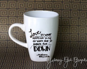 """Firefly Quote Mug """"Love is what keeps her in the air when she oughta fall down"""" -Captain Malcom Reynolds, white black letters"""