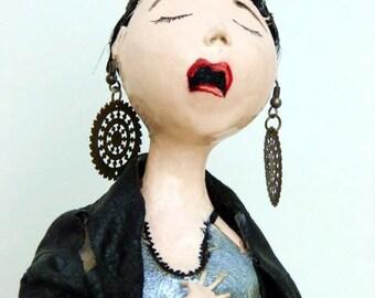 Singer: doll; sculpture; Portuguese handicraft