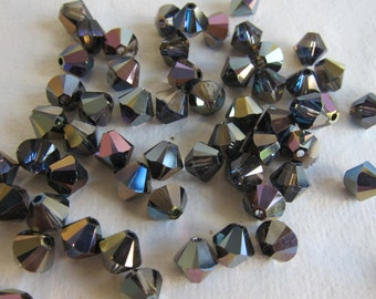 6mm, Swarovski, Art 5328, Faceted Crystal Bicones, Crystal Heliotrope - Available in 10, 20 & 30 Bead Pkgs, Larger Pkgs and Factory Packs