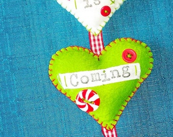 Santa Claus is coming to town hanging hearts
