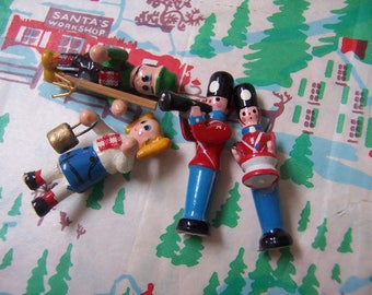 four wee little wooden figurines