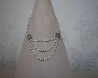 White pearl and silver triple strand necklace