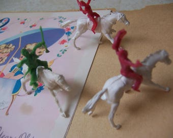 three tiny horses with riders