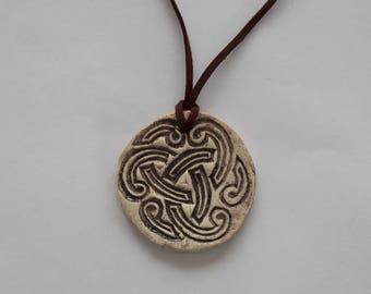 Round ceramic pendant with printing flowers Burgundy spirals