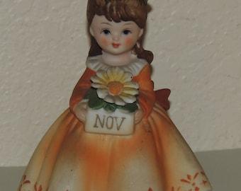 Lefton November Birthday Figurine