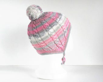 Hand knitted girls pink hat with pom pom. Handmade to order.