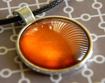 Orange Twist Orange Nail Polish Glass Gem Circle Pendant Silver Tray Black Cord