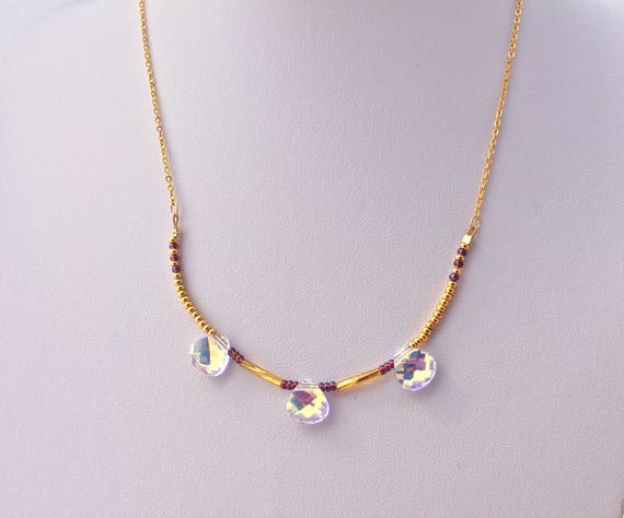 Necklace wedding  with a golden plated chain enhaunced by  3 faceted    pendant drops white swarovski  drops and seed beads