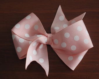 Pink and white polka dot bow clip
