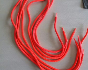 four neon orange vintage shoe laces