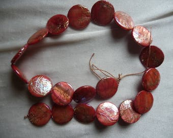 Beads, Mother of Pearl, 20mm Flat Round Coin, Shades of Orange with Design. Sold per 15 inch strand. There are 20 beads on the strand.