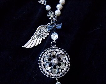 """Bling round pendant crystal and pearl statement necklace with large crystal laden circular 2"""" pendant with large silvery wing"""