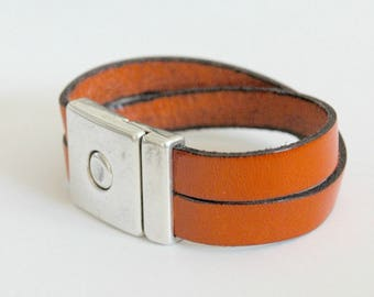 Orange leather and silver clasp