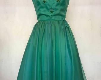 1960's Green chiffon princess style vintage dress.  Embellishment on the bodice and flared circle skirt bottom.