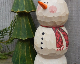 Hand Carved Snowman and carved tree.