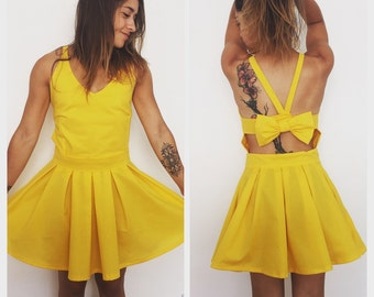 Yellow Sun dress open in the back with bow