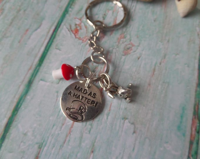"""ALICE in WONDERLAND inspired 20mm """" mad as a hatter """" silver tone 3 charm keyring Mad Hatters Tea Party FAN gift xmas Uk"""
