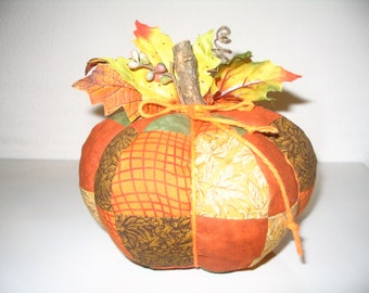 Halloween and Thanksgiving Pumpkins made of quilted cotton fabric or upholstery material.They come in three sizes.3, 6, and 12 inches tall.