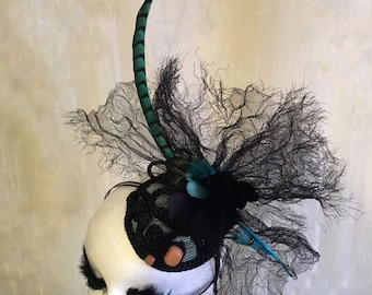 Crinoline and lady pheasant feather fascinator