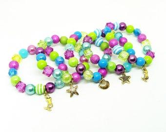 Girl's Under the sea Mermaid bracelet favors in organza bags with special birthday girl bracelet!