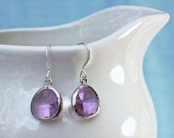 purple earrings with silver bezel setting. Framed and faceted in lavender