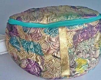 Bum bag or hip bag.