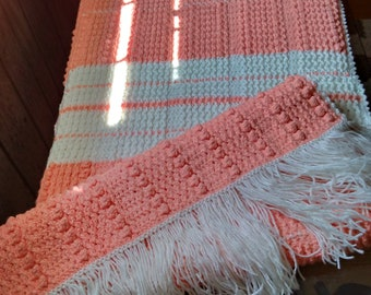 peach and white crocheted afghan