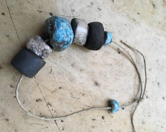 set of blue and white raku beads