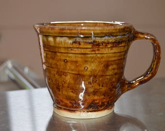 Brown cup with handle
