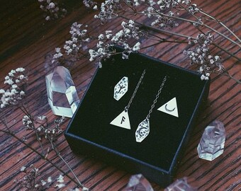 A pair of odd earrings. Bespoke, Custom (sterling silver - your choices of shape, length & stamp: rune, moon, triangle, ankh, arrow, sun...)