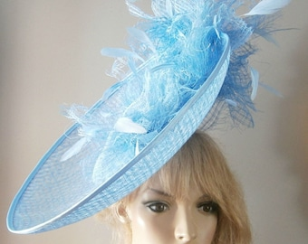 hand made pale blue,lattice weave sinamay saucer hat with sprays of soft coque feathers & headband attachment.
