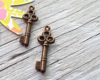 Antiqued brass charm - brass key charm double sided vintaj set of 2
